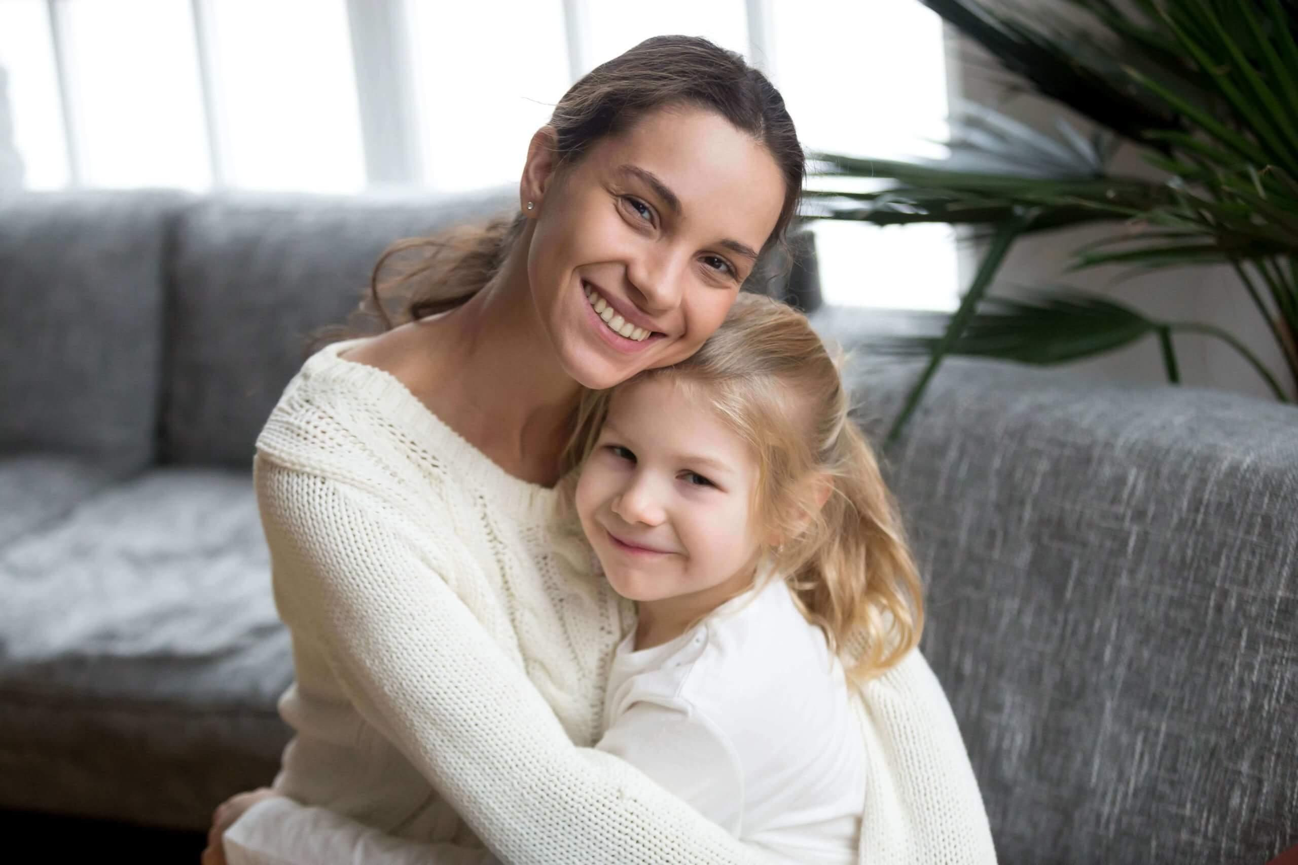 portrait-happy-loving-single-mother-hugging-cute-little-daughter-min (1) (1)
